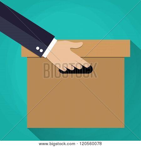 Hand carrying a cardboard box.