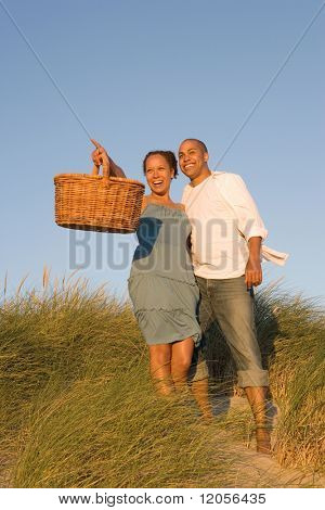 Couple with picnic basket at beach