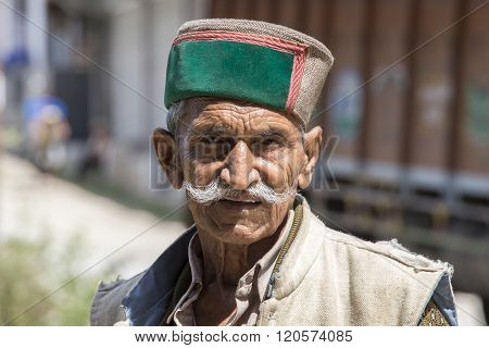 MANALI INDIA - SEPTEMBER 14 2014: Old unidentified local man outdoor in Manali . The majority of the local population are descendant of Tibetan.