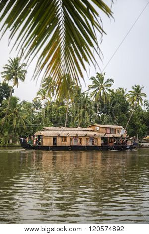 KERALA, INDIA - OCTOBER 16, 2015: Unindetified people at backwaters in Kerala India. The backwaters are an extensive network of 41 west flowing interlocking rivers lakes and canals that center around Alleppey Kumarakom and Punnamada.