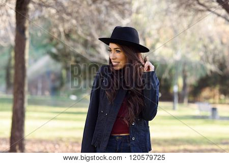 Portrait Of Young Woman Smiling In Urban Park