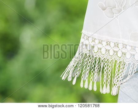 Fragment Of Lace Curtains On The Background Of Green Trees