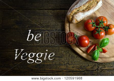 Tomatoes With Bread On Wooden Table, Text Be Veggie