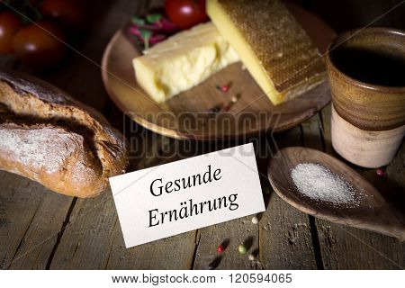 Cheese, Bread, Salt And Vegetables On A Wooden Table, Card With Gesunde Ernährung