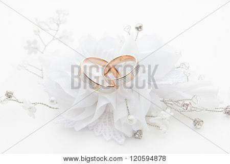 Wedding rings on wedding card on a white background