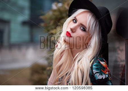 Portrait Of Pretty Blonde Woman With Makeup Outdoors
