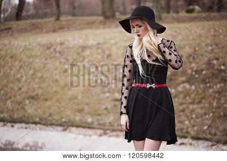 Beautiful Girl In Posing Outdoors
