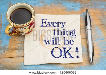 Everything will be OK! Handwriting on a napkin with a cup of coffee and pen.