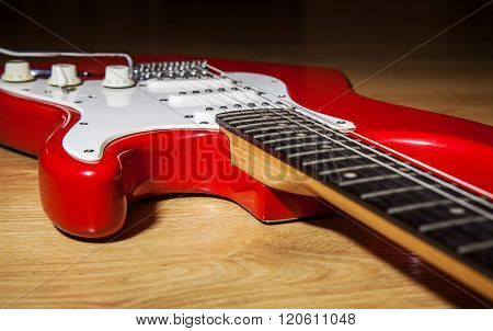 Body Part Of Red 6 String Guitar