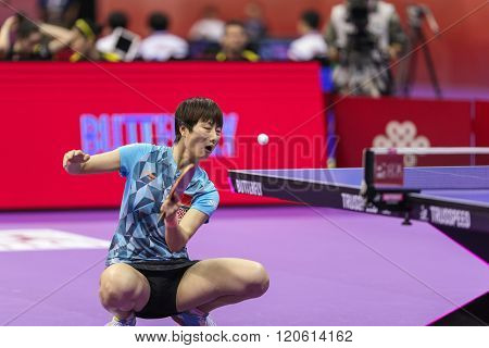 KUALA LUMPUR, MALAYSIA - MARCH 01, 2016: Ding Ning of China serves from the corner of the table in her match in the Perfect 2016 World Team Table-tennis Championships held in Kuala Lumpur, Malaysia.