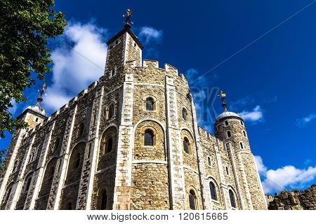 LONDON UK - JUNE 6 2015 : Historic The White Tower at Tower of London historic castle on the north bank of the River Thames in central London - a popular tourist attraction