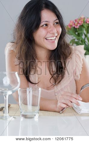 Young woman sitting at the dinner table