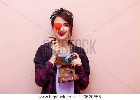 Portrait Of A Young Woman With Camera And Toy