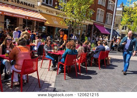 Unidentified Tourists And Locals At South Kensington Area At Summer Day. London
