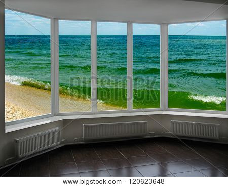 plastic window with view of marine waves