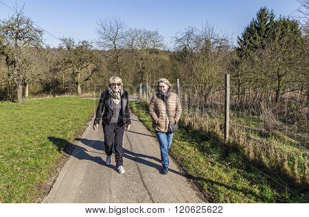 Mother And Daughter Have A Walk On A Sunny Day