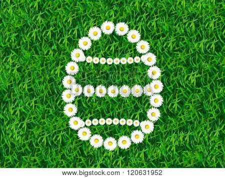 Daisy chain in shape of Easter egg on grass background