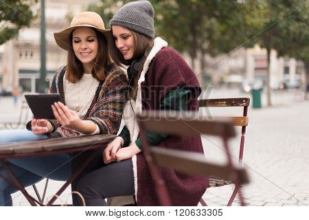 Friends In Tablet On Street
