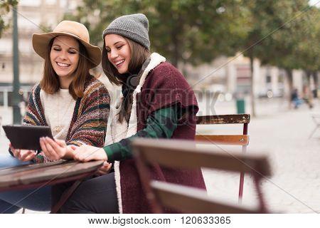 Friends In Tablet On Street