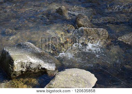 clear creek water crashing into rocks
