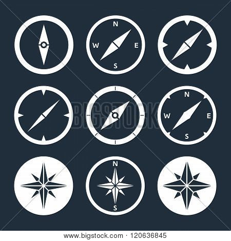 Compass flat icons set. Vector icons of a navigational compass in flat style. Windrose design elements. Compass pictograms. EPS8 clean vector illustration.