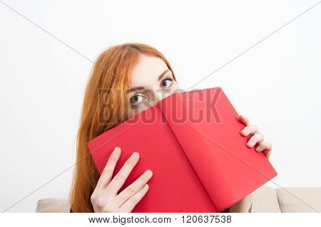 Young Redhead Woman Eyes On Red Cover Book Portrait