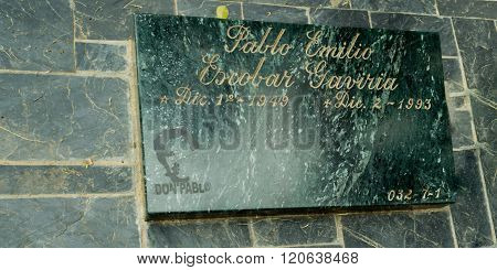 MEDELLIN COLOMBIA - JANUARY 4: Tombstone of Pablo Escobar as of January 4 2012. Pablo Emilio Escobar Gaviria was a notorious Colombian drug lord who was shot and buried in Medellin Colombia