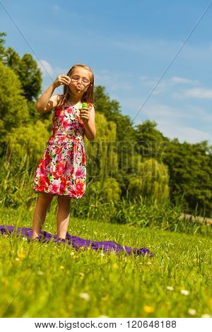 Little Girl Child Blowing Bubbles Outdoor.