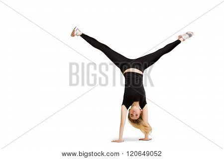 Caucasian woman doing cartwheel isolated on white