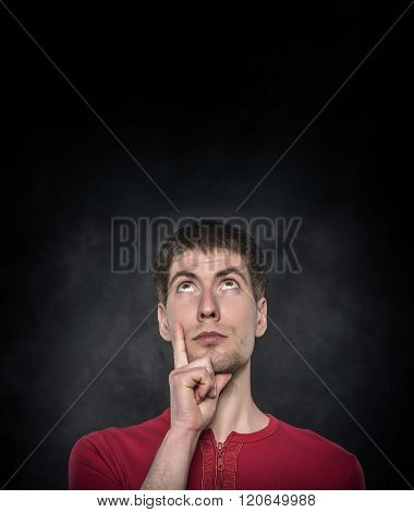 Young man thinking.