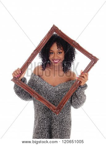 African American Woman Looking Trough Picture Frame.