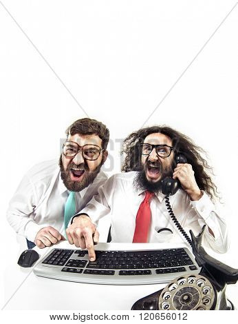 Two weird computer geeks having fun on computer