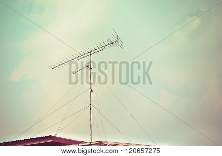 Old antenna with blue sky background. Silhouetted image