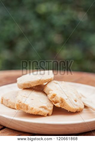 Cashew cookies on wooden plate, stock photo
