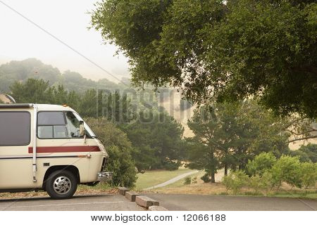 Recreational vehicle parked by country road