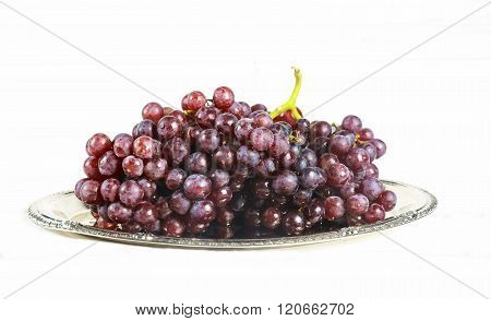 glass of wine and grapes, isolated on white  wine grapes