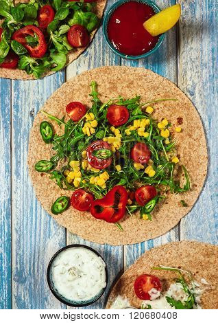 Tako Tortillas With Corn, Cherry Tomatoes And Sauces