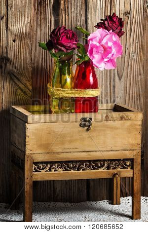 Roses On Wooden Tables