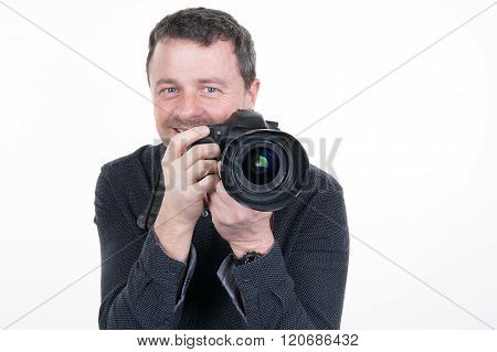 Happy Man With Camera. Isolated Over White Background.