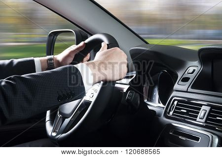 Close Up Of Young Man Driving Car