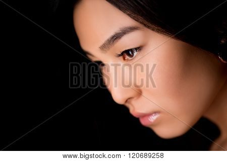 Close-up profile of asian lady in studio