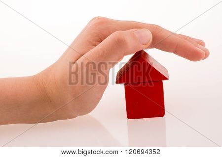 House With Cubes In Hand