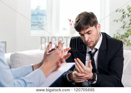 Depressed businesman talking with psychologist