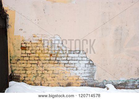 Industrial background, empty grunge urban street warehouse half plastered brick wall
