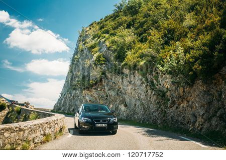Black colour Seat Leon 5-door car on background of French mounta