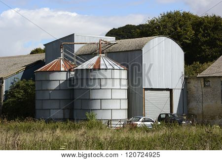 Grain Store Silos On English Farm