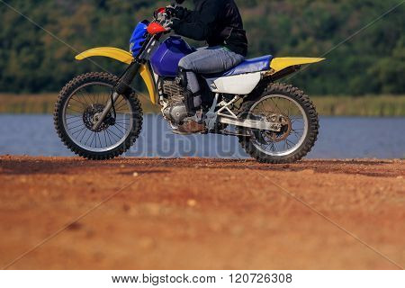Man Riding Enduro Motorcycle On Dirt Field