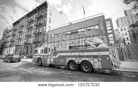 Fdny Fire Truck Parked In Front Of Engine House.
