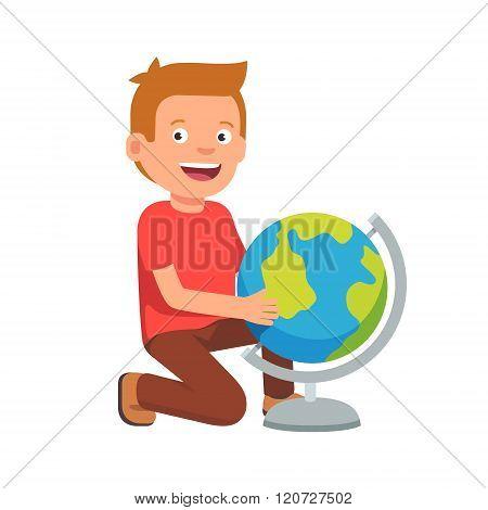 Kid sitting at terrestrial globe