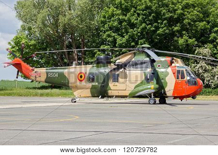 BEAUVECHAIN BELGIUM - MAY 20 2015: Belgian Navy Sea King rescue helicopter on the tarmac of Beauvecahin airbase.